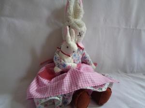 Mummy bunny and baby sitting